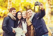 summer, holidays, vacation, travel, tourism, happy people concept - group of friends or couples havi