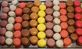 Traditional french macarons in a rows. Colorful macaroon background.