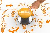The word hosting and hand pointing against yellow push button