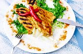 picture of curry chicken  - Grilled chicken with curry spices and chilli peppers - JPG