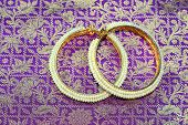 foto of bangles  - Indian pure silk saree also called Kancheepuram saree is a traditional dress worn by the Indian women for wedding and festivals. Made of gold zari and pure silk. Matching pearl bangles. ** Note: Soft Focus at 100%, best at smaller sizes - JPG