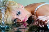 pic of prostitution  - Drunk attractive woman with a drinking glass - JPG