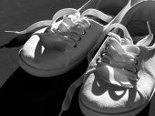 white tennis shoes in black and white