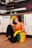 Attractive Overworked  Woman In Kitchen