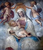 PARMA, ITALY - MAY 01,2014: Blessed Virgin Mary with baby Jesus, street wall painting, Parma, Emilia-Romagna. Italy, on May 01, 2014