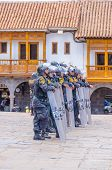 CUZCO, PERU, MAY 1, 2014 - Policemen in tactical vests and special equipement control the 1 May mani
