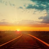 good orange sunset over railroad to horizon