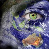 Oceania Painted On Face With Green Eye - Elements of this image furnished by NASA