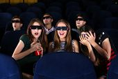picture of cinema auditorium  - Young people watching movie in cinema - JPG