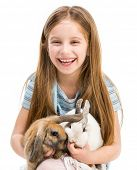 image of tame  - cute little girl with two Easter rabbits isolated on white - JPG