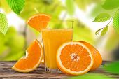 Fresh orange juice, healthy drinks on wooden table.