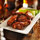 bbq chicken wings with celery on plate