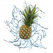 Fresh pineapple with water splash over white background
