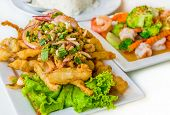 Spicy Deep Fried Squid Mingle Serve With Broccoli Prawn Salad. A Delicious Thai Cuisine Lunch Menu.