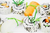 California Roll with Avocado and Salmon, Cream Cheese and Raw Salmon inside. on long white plate . i