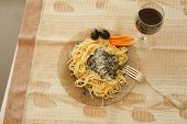 Pasta With Sauce Pesto,   Black Olives, And Wine
