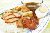 picture of crispy rice  - BBQ Pork sausage and crispy pork over the rice thai food style - JPG