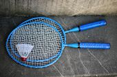 image of shuttlecock  - Two blue badminton racquets with white shuttlecock - JPG