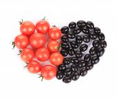 Tomatoes and olives in shape of heart.