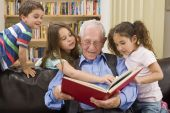image of storytime  - grandfather reading a story to his grandchild - JPG