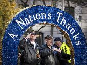 NEW YORK - NOV 11, 2014: A US vet salutes the crowd from a float with a banner that says A Nations Thanks at he 2014 America's Parade held on Veterans Day in New York City on November 11, 2014.
