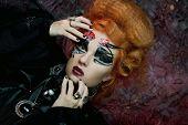 Gothic redhair witch. Dark woman.Halloween picture.