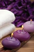 stock photo of swedish sauna  - purple candles with white towel in spa setting - JPG