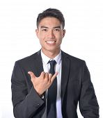young business man with arm out in a hands gesture