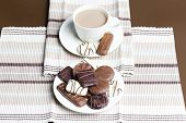 cup of coffee with chocolate biscuits