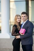 Young man gives a woman gift