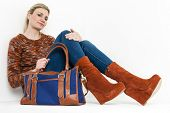 picture of platform shoes  - sitting woman wearing fashionable platform brown shoes with a handbag - JPG