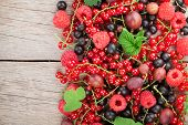 Fresh ripe berries on wooden table background with copy space