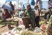 OROMIA, ETHIOPIA- NOVEMBER 5, 2014: Unidentified vegetable seller and her daughter sell their wares in open market in Ethiopia