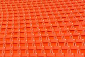 stock photo of bleachers  - red seats on the stadium steps bleacher - JPG