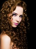 stock photo of black curly hair  - Attractive young woman with long ringlet hairs  - JPG