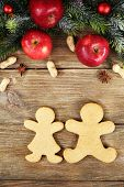 Christmas cookies and fruits on wooden table