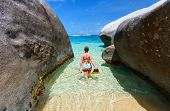 picture of virginity  - Young woman with snorkeling equipment at tropical beach among granite boulders at Virgin Gorda - JPG
