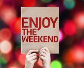Enjoy The Weekend card with colorful background with defocused lights
