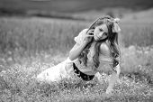 young beautiful woman on cereal field with poppies in summer - black and white image