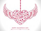 Decorated hanging pink heart with wings for Happy Valentine's Day celebration.
