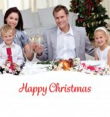Parents toasting with wine in Christmas dinner against happy christmas