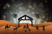 stock photo of nativity scene  - Nativity scene against black abstract light spot design - JPG