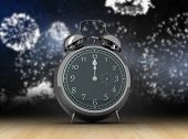 image of count down  - Alarm clock counting down to twelve against wooden planks - JPG