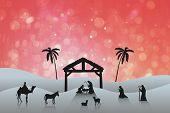 Nativity scene against red abstract light spot design