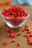 Dried Goji berry in a bowl. Selective focus on the bowl
