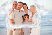 Portrait of a smiling family at the beach against house outline in clouds
