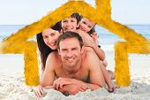 Family on the beach against house outline in clouds