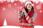 Festive brunette with gift against blurred fir tree background