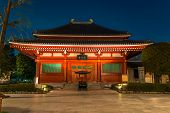 TOKYO, JAPAN - APRIL 7 Imposing Buddhist structure features a massive paper lantern painted in vivid