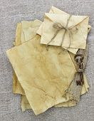 Antique paper letters and envelopes with bronze skeleton key